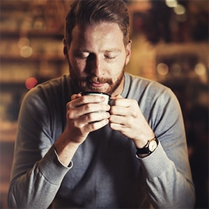 Man Savoring TRUBRU Coffee